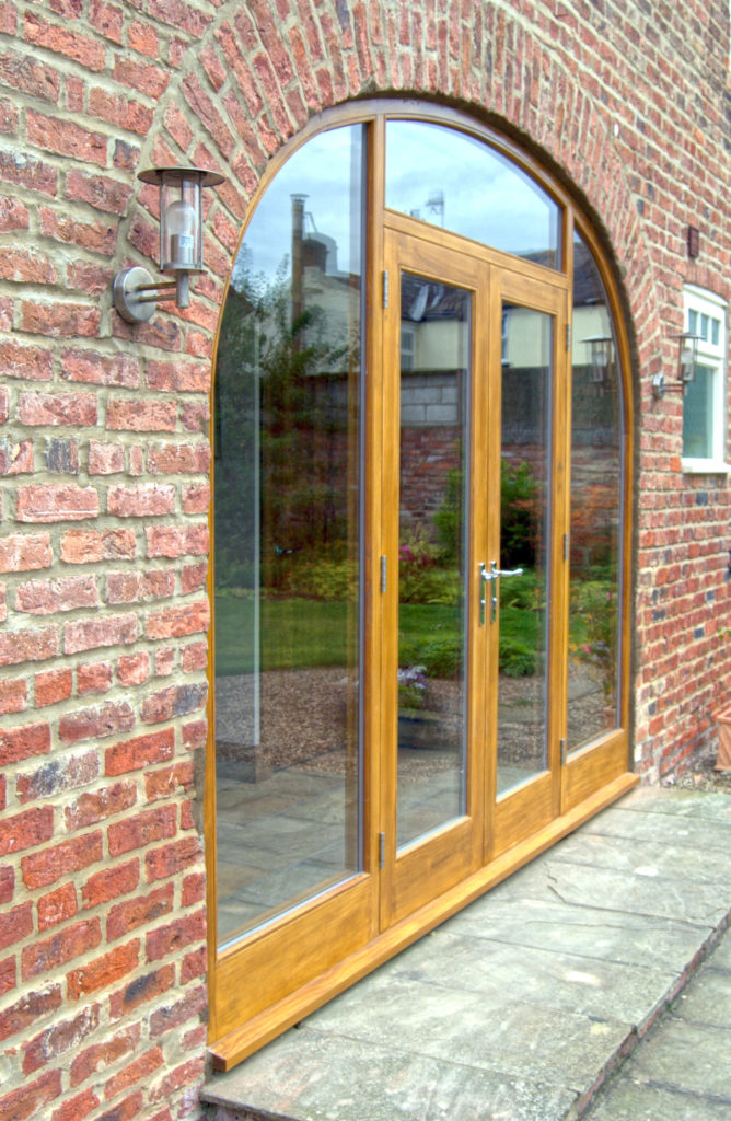 Photograph of a large bespoke wooden window made from Accoya® wood and fully double glazed.