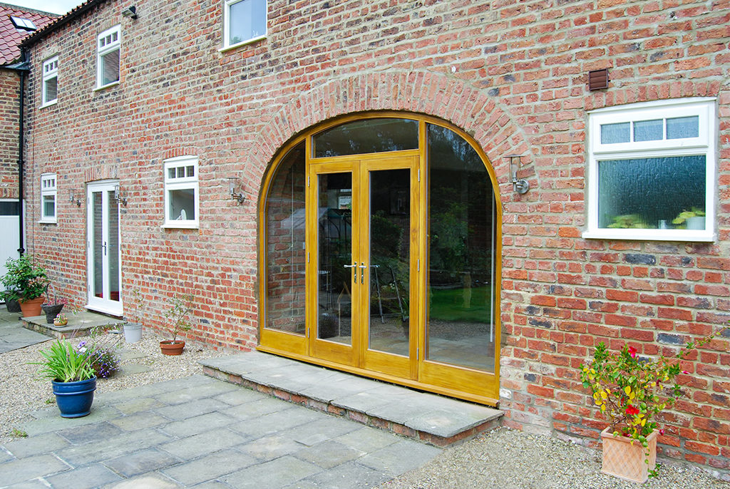 A made-to-measure wooden window installed in a quality barn conversion in North Yorkshire.