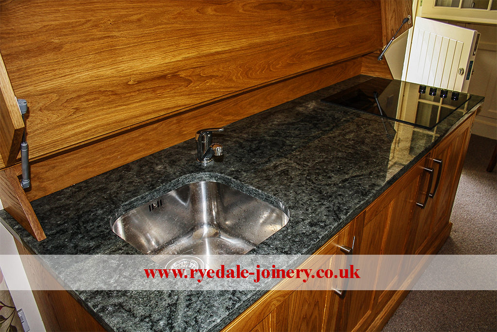 An image of a high quality kitchen sink unit in polished wood.