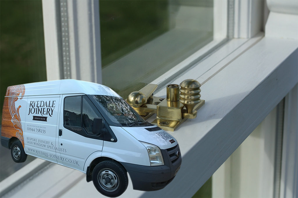 An image of a double-glazed sash window with a Ryedale Joinery vehicle in the lower left corner.
