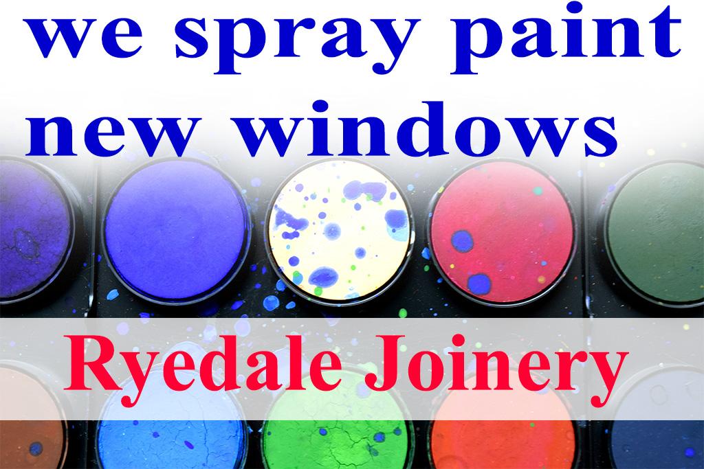 An image showing paint pots of various coloured paints.