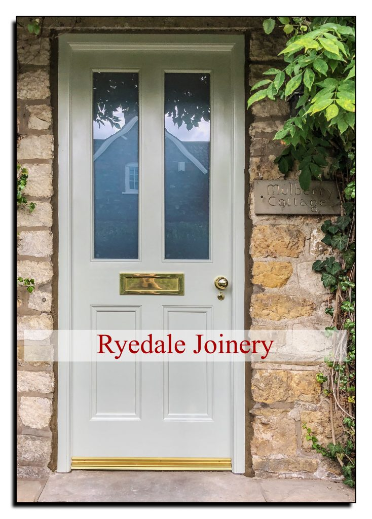 Wooden external door with two double glazed panels.